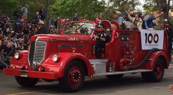 The Davis Town Council riding in a vintage firetruck.