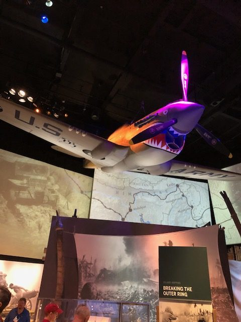 """A shark-faced P-40 Warhawk hangs in the """"Road to Tokyo"""" exhibit at the National World War II Museum in New Orleans, LA."""